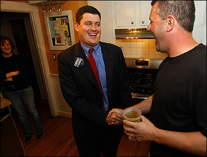 John R. Connolly, 32, candidate for at-large councilor and the son of a former secretary of state, Michael J. Connolly, greeted his host, Paul McCarthy, at a recent house party in Dorchester.