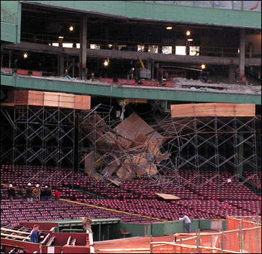 Scaffolding located below Fenway Park's .406 club behind home plate fell into the seating area below on Friday.