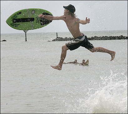 Chris Bowden took advantage of the strong surf yesterday to skimboard on the South Marco beach in Marco Island, Fla.