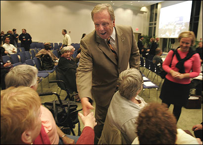 Stephen J. Murphy, seeking to retain his at-large council seat, greeted people before the start of a forum at the University of Massachusetts at Boston last week.
