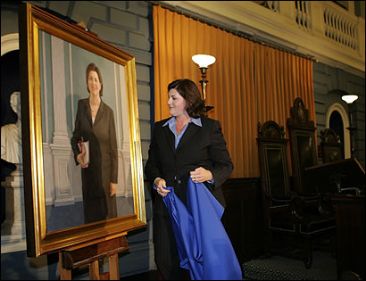 Jane Swift, former acting governor, after she unveiled her portrait in the Senate chamber yesterday.
