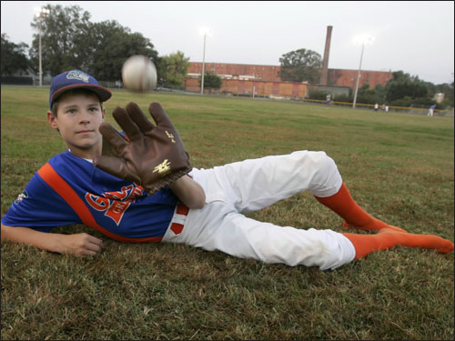 In honor of his distant relative, Joseph Jackson, 13, wears a replica glove and, of course, no cleats, while at Shoeless Joe Memorial Park.