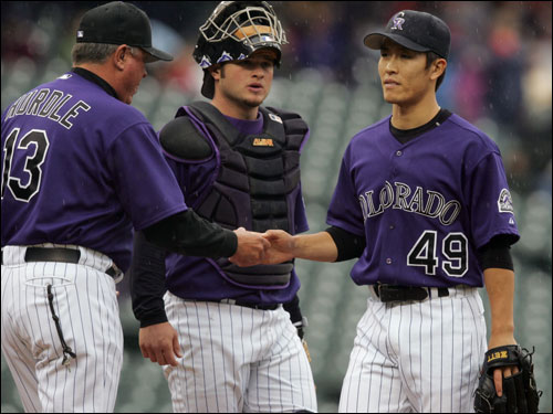 Theo traded the 26-year-old Korean reliever (pictured, right) to the Colorado Rockies in March, agreeing to pay all but roughly $315,000 of the $6 million owed to Kim in 2005. In return, the Sox received a midlevel minor league prospect, lefthanded pitcher Chris Narveson, who was optioned to Triple-A Pawtucket.