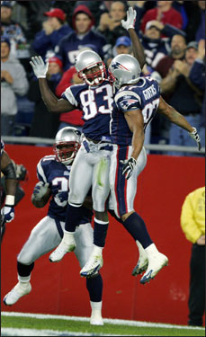 Branch (left) and Givens (right) jumped for joy after Branch scored a touchdown on a pass from Brady (not pictured).