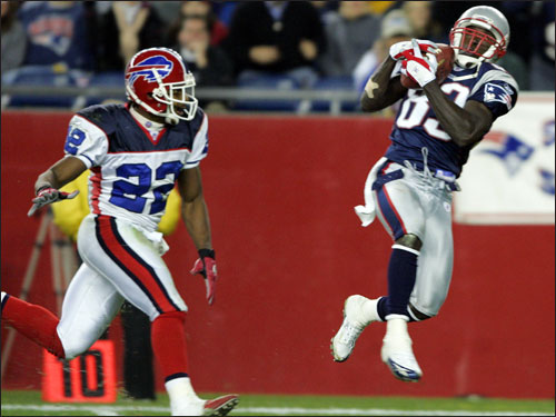 Patriots widereciever Deion Branch (right) hauled in a touchdown pass from Brady, beating Bills cornerback Nate Clements to put New England ahead in the third quarter.