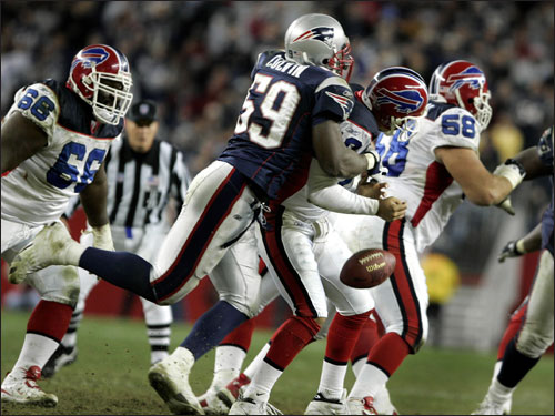 Colvin (59) forced Holcomb to fumble the ball with a hit from behind in the fourth quarter. Colvin recovered the ball, and the play set up the Patriots for the game-winning touchdown.