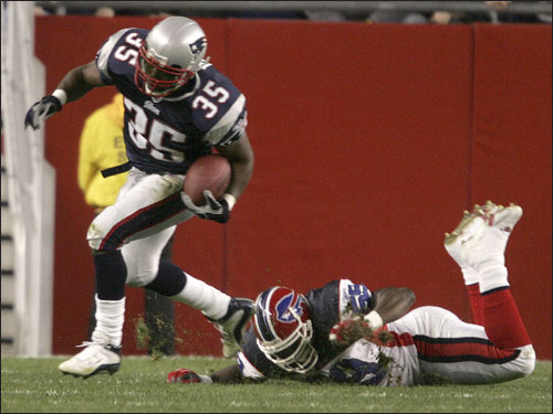 Patriots fullback Patrick Pass broke a tackle by Bills cornerback Eric King during the first quarter.