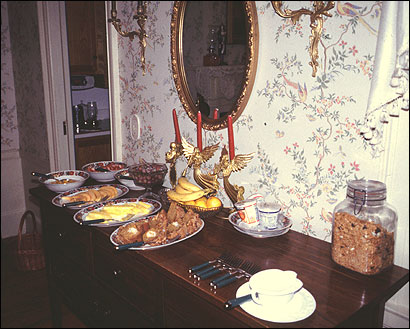 Continental breakfast is set up on the dining room buffet
