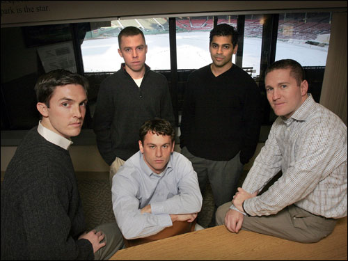 The Red Sox will likely take a look at some of Theo's top assistants, including assistant to the GM Jed Hoyer (one of Theo's closest confidants; second from left, seated), and Ben Cherington (not pictured), director of player development. These would appear to be long shots, but stranger things have happened. Former director of baseball operations, Peter Woodfork (second from right), has accepted an assistant GM position with the Arizona Diamondbacks.