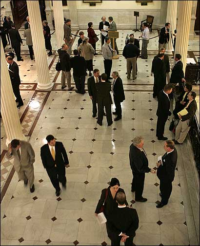 The hall outside the Massachusetts House was filled with lawmakers, lobbyists, and others yesterday, as debate proceeded on legislation to extend health insurance to all state residents.