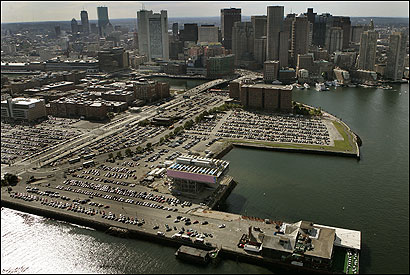 DEVELOPMENT Menino said the South Boston Waterfront (above, in August) and the Rose Fitzgerald Kennedy Greenway are key goals. Hennigan said vacant area buildings could be conver