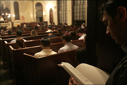 Boston's oldest synagogue, the Vilna Shul on Beacon Hill, now serves as a cultural center and an informal place to experience Judaism. David Gerzof, 30, standing at the rear during a service, helps organize events at the shul.