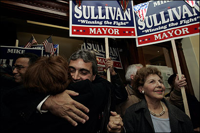 In Lawrence, Mayor Michael J. Sullivan (center), was accompanied by his mother, Anne, (right) as he thanked supporters at Lawrence City Hall.
