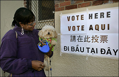 Holding her dog, Precious, Sha'ron Jenkins emerged from voting at the Lucy Stone School in Dorchester.