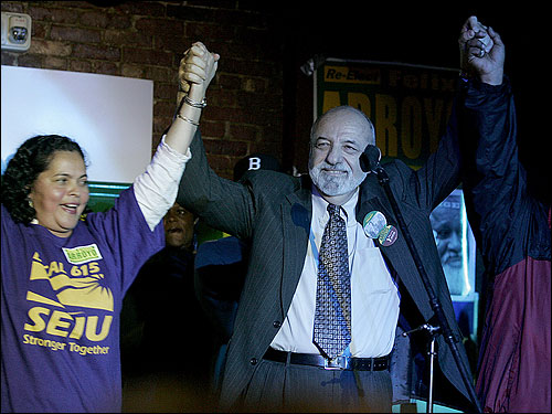 Councilman Felix Arroyo (right) raised his hands in a gesture of victory with supporter Antonia Cardona while they celebrated after the election at Estelle's in Boston on Tuesday.
