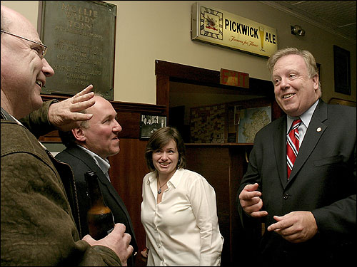City Council hopeful Steve Murphy (right) greeted friends and supporters after learning of his victory on Tuesday night.