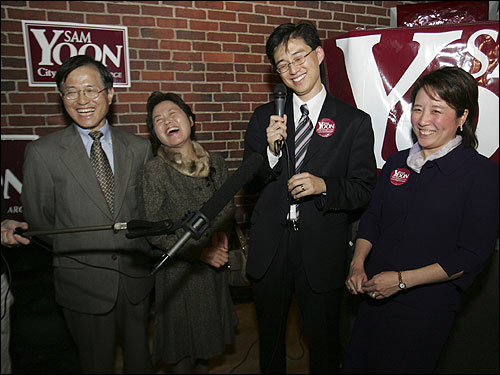 Sam Yoon, with his wife Tina (right), his father Won Khill Yoon and his mother Mann Kang Yoon announced his victory Tuesday night as Boston's first Asian-American elected to the Boston City Council.
