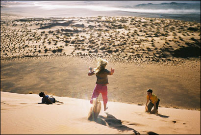 Paige Donnelly and her brothers Gavin and Wyatt play on one of the Sossusvlei Dunes in Namib-Naukluft Park.