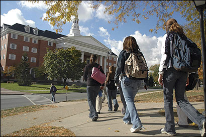 Students headed to the Billy Graham Center on Wheaton College's campus in Wheaton, Ill. Graham, a graduate, inspires many to avoid secular student behavior.