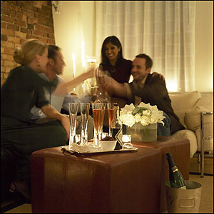 Priya Tahiliani and fiance Craig Haas (right) toast another couple at Ed Macri's party.