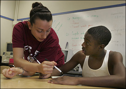 Carli Parisella, program manager of the after school tutoring program at Clarence R. Edwards Middle School in Charlestown, worked with Reggie Hobbs,13, last week.