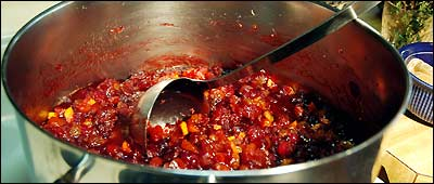 Carol Wasik of Dover prepares cranberry chutney with crystalized ginger, dried apricots, oranges, onions, raisins, apple cider vinegar and thyme in her kitchen.