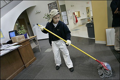 Hein Vu, a seventh-grader at Dorchester's Epiphany School, took his turn mopping floors.