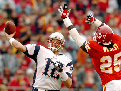 Brady got a first half pass off under pressure from Kansas City Chiefs safety Greg Wesley.