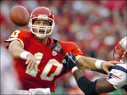 Chiefs quarterback Trent Green got off a pass under pressure from a Patriots defender.