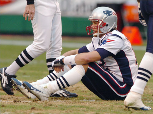 Brady sat on the field after being sacked by Chiefs defensive end Jared Allen.