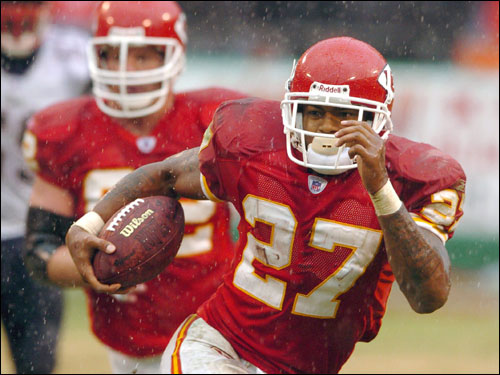 Chiefs running back Larry Johnson made a gain in the rain during the fourth quarter.