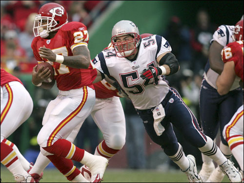 Tedy Bruschi closed in on Chiefs running back Larry Johnson. Johnson rushed for 119 yards.