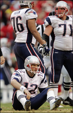 Brady sat on the ground after getting sacked by defensive end Jared Allen.