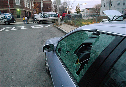A car with a shattered window was parked across the street from the John Winthrop School in Dorchester yesterday. No one was injured, police said.