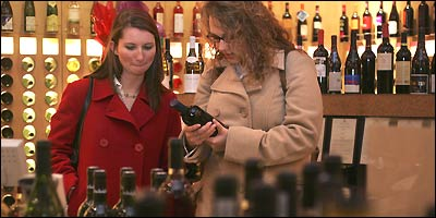 Sisters-in-law Emily Little (left) and Amy Little shop at Best Cellars in Boston.