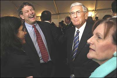 Edythe Board and Ely Broad mingle with the crowd as Eric Lander, head of Broad Institute, and Aviv Regev, chats with them