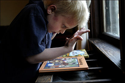 Six-year-old William Hansen, at home in Framingham, is autistic just like his brother, Jacob. Their parents are convinced that vaccinations triggered the disorder in both boys.
