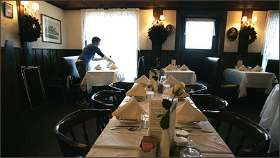 Manager Dan LaFlamme sets tables for dinner at the Whately Inn.