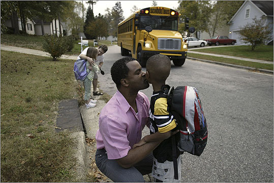 Raymond Johnson, with son Cole, is a former Malden resident who moved his family to North Carolina last year.