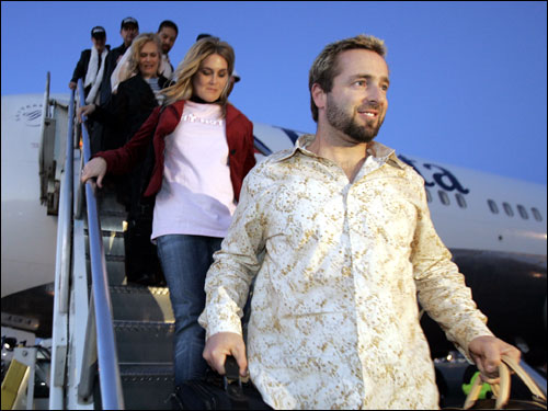The Red Sox are a team in transition. Many familiar faces are out, or looking to get out. We take a look at back at these former or potentially soon-to-be former Sox ... Kevin Millar, shown here arriving at Logan Airport after the Red Sox won the World Series in 2004, was not offered salary arbitration by the Sox and is hoping to sign on with another team.
