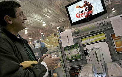 Robert Castaldo, trying out an Xbox 360 demo at the Best Buy in Braintree yesterday, has been on a five-week search.