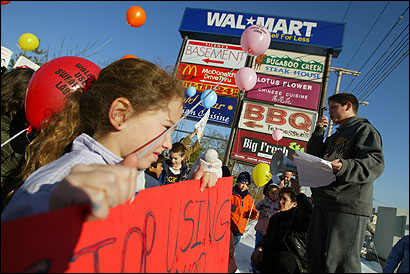 Molly Hershkowitz (left) and Lucian Casciano of the Workmen's Circle in Brookline were among the protesters yesterday at the Wal-Mart in Framingham. The demonstration resulted from accusations of labor abuses in several of the chain's properties.