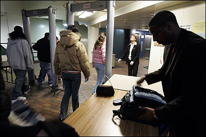 Students at Madison Park Technical Vocational High School in Roxbury, filing last week through a metal detector, go through the ritual each morning. The school district requires 15 of the city's 38 high schools to screen every student daily, but not all comply.