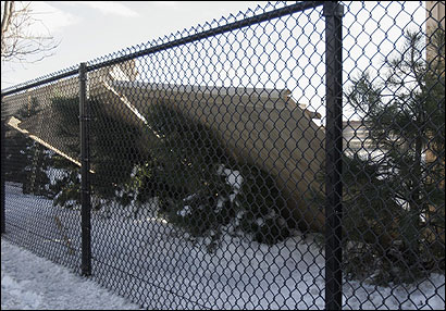 A wooden fence fell along the Massachusetts Turnpike in Allston; residents are demanding more lasting protection.