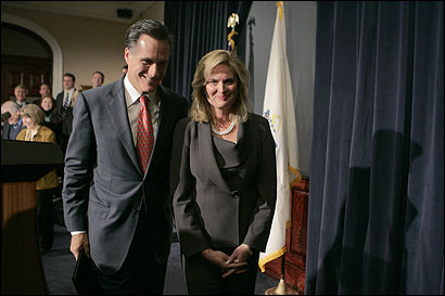 Governor Mitt Romney and his wife, Ann, after a State House press conference. On his political future, he said, ''I'm not going to close any options at this point.''
