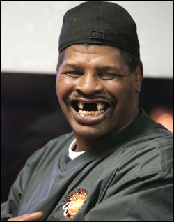 Former heavyweight champ Leon Spinks still has his famous gap-toothed grin, the one he first displayed after upsetting Muhammad Ali in 1978, though he now toils as a weekend custodian at the YMCA in Columbus, Neb. (Globe Staff Photo / Stan Grossfeld)   Riddle of the Spinks