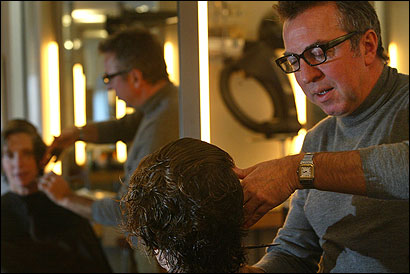 Mario Russo, cutting Wendy Everett's hair yesterday, said Johnny Damon gave Boston ''a new identity, a new hipness.''