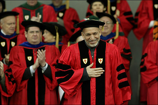 Afghanistan President Hamid Karzai spoke at Boston University's 2005 commencement on May 22 before heading to Washington, D.C., for a meeting with President Bush. At left, Karzai acknowledged cheers before receiving an honorary Doctor of Laws degree. <img src ='http://cache.boston.com/bonzai-fba/File-Based_Image_Resource/dingbat_arrow_icon.gif' alt='' title='' height='9' width='4' border='0' /> <a target='new' href ='http://www.boston.com/news/education/higher/articles/2005/05/23/do_not_ignore_others_pain_karzai_says_at_bu'>Story