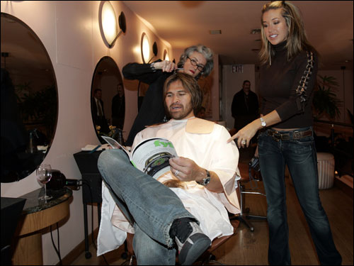Stylist Chantal (left) gave Damon his inaugural Yankee haircut as his wife, Michelle (right), looked on.