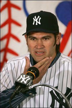 Johnny Damon stroked his clean-shaven chin as he was being introduced by the New York Yankees.